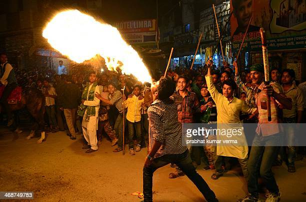 CONTENT] Shia Muslim blowing fire with his mouth during participating in Muharram procession in Allahabad