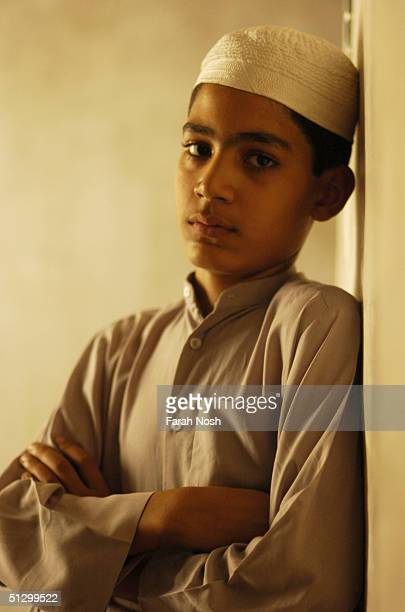 Shia Muslim boy stands in his home July 5 2004 in Iraq The boy has been studying Howza Elmiya for three years