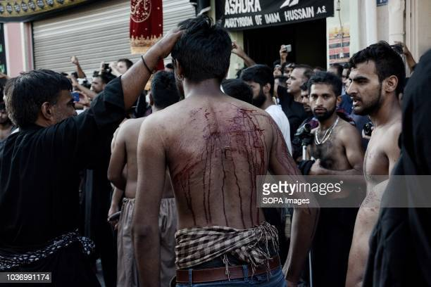Shia Muslim mourner seen flagellated during the Ashura commemoration when Shia Muslims mourn the slaying of the Prophet Mohammed's grandson Imam...