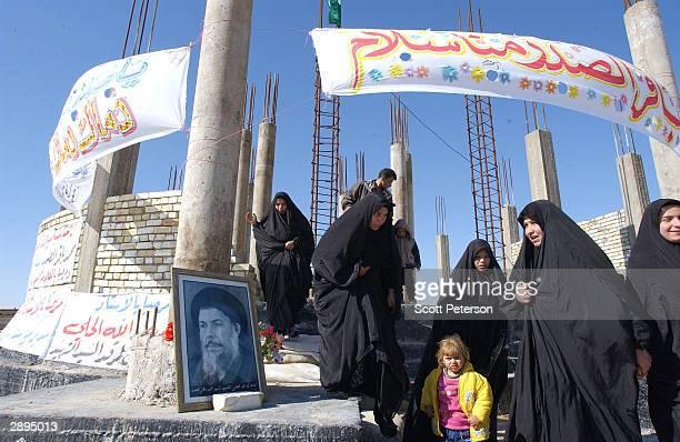 Shia Muslim women visit the grave of Grand Ayatollah Mohamed Bakr alSadr a revered antiregime cleric killed in 1980 by the Saddam Hussein regime on...