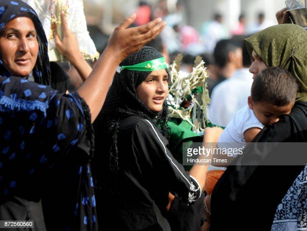 Shia Muslim worshippers gather for mourning procession during the Shia Muslim festival of Chehlum in connection with the remembrance ceremonies for...