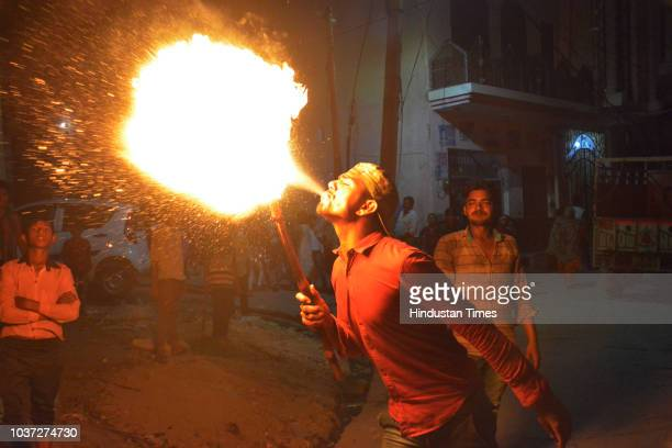 Shia Muslims beat their chest as they participate in a Muharram procession on September 21 2018 in Jammu India Ashura mourns the death of Imam...