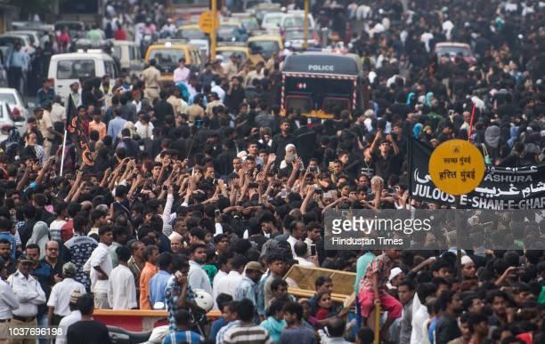 Shia Muslims participate in a Muharram procession near JJ Hospital on September 21 2018 in Mumbai India Ashura mourns the death of Imam Hussein a...
