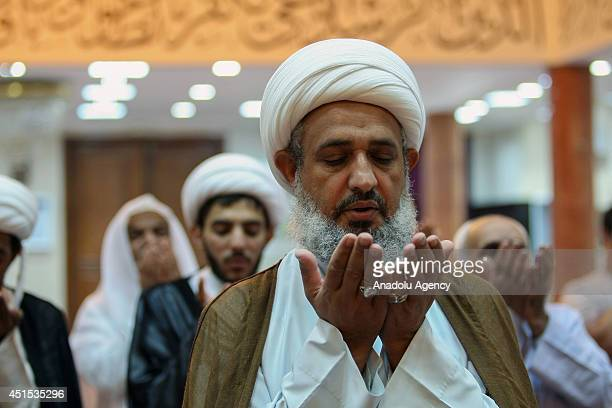 Shia Muslims perform their evening prayer at Imam Ali Mosque on June 30, 2014 in Manama, Bahrain. Muslims fast, pray and read the Holy Book Koran...