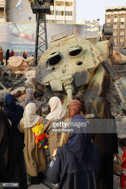 Shia School girls covered in veil stand in front of a Israeli Markava tank which was destroyed by Hezbollah forces in 2006 war with Israel on August...