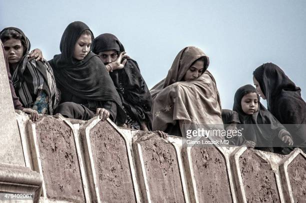 CONTENT] Shia women during Muharram all veiled and separate from the men mourning and expressing deep sorrow DELHI Islamic holiday