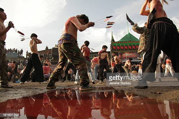 CONTENT] Shia worshippers whip themselves with knives turning the streets red with blood outside a shrine in Kabul Dec 12 2010