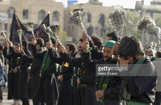 Shiah Muslim crys as he practice selfflagellation to express his grief for Ali's death during the celebration of the Muharram February 29 2004 in...
