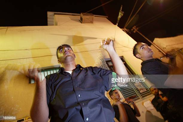 Shiahs Muslims flail themselves with chains during the last day of azaeHussain November 25 2002 in Manama Bahrain With the pain that they endure...