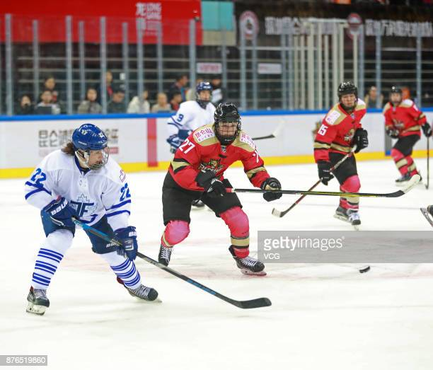Shiann Darkangelo of Kunlun Red Star WIH and Ella Stewart of Toronto Furies vie for the puck during the 2017/2018 Canadian Women's Hockey League CWHL...