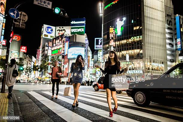 shibuya crossing at night tokyo japan - japanese short skirts stock photos and pictures