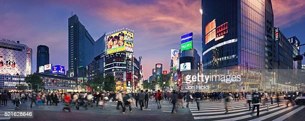 shibuya crossing at sunset. - shibuya ward stock pictures, royalty-free photos & images