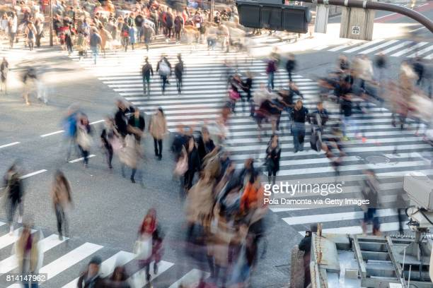 shibuya crossing at tokyo, japan - crossroad stock pictures, royalty-free photos & images