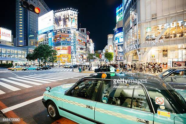 Shibuya crossing with illuminated neon signs at night, Tokyo, Japan