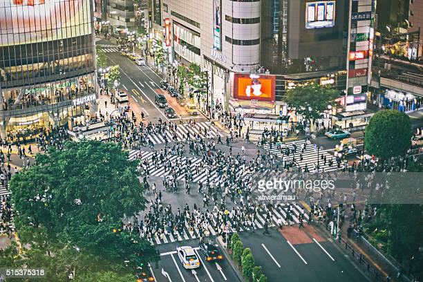 shibuya ward - overhead view of traffic on city street tokyo japan stock photos and pictures
