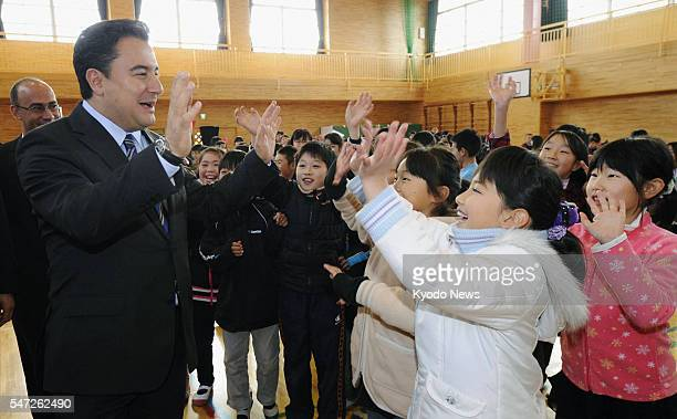 Shichigahama Japan Turkish Deputy Prime Minister Ali Babacan on Dec 7 meets with students at an elementary school in the Miyagi Prefecture town of...
