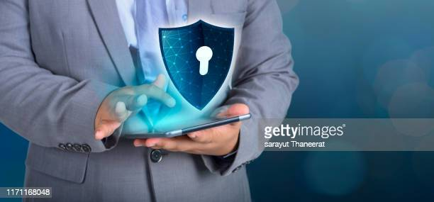 shield internet phone smartphone is protected from hacker attacks, firewall businesspeople press the protected phone on the internet. space put message - data privacy stock pictures, royalty-free photos & images