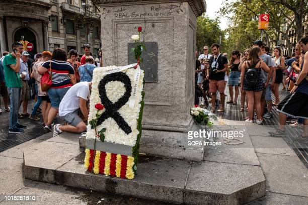 A shield of flowers is seen deposited at the Ramblas Barcelona celebrated the first anniversary of the terrorist attack on the Ramblas at the Plaza...