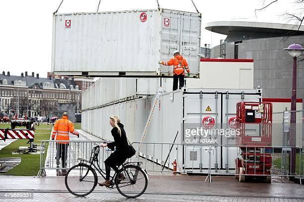 Shielding fences and containers are being placed on the Museumplein in Amsterdam on March 21, 2014 before the visit of the US President at the...