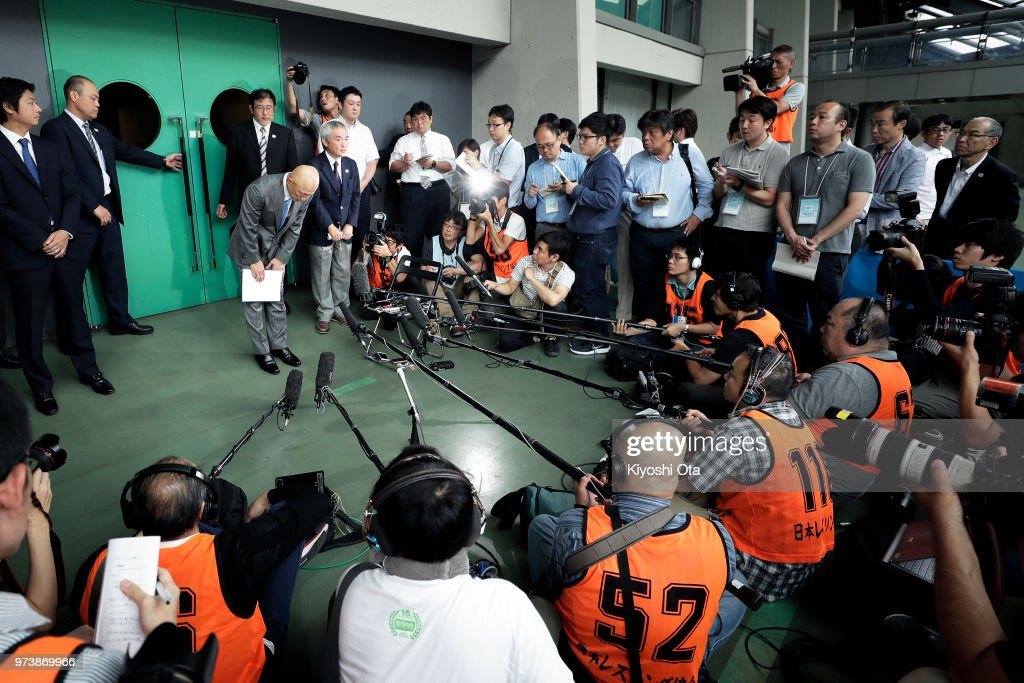 Shigakkan University wrestling team coach and former development director at Japan Wrestling Federation (JWF) Kazuhito Sakae (L) bows in front of members of the media on day one of the All Japan Wrestling Invitational Championships at Komazawa Gymnasium on June 14, 2018 in Tokyo, Japan.