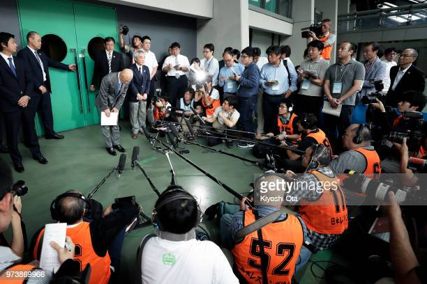 Shigakkan University wrestling team coach and former development director at Japan Wrestling Federation Kazuhito Sakae bows in front of members of...