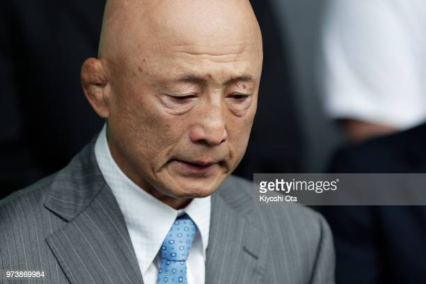 Shigakkan University wrestling team coach and former development director at Japan Wrestling Federation Kazuhito Sakae reacts while speaking to...