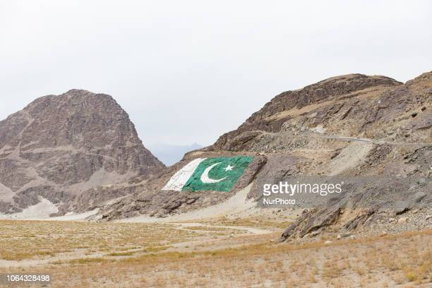 Shigar, Pakistan, 29 September 2018. A view of a Pakistani flag painted on the cliff at the entrance to the Shigar Valley. It is one of the most...