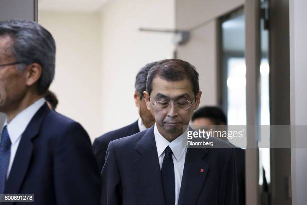 Shigehisa Takada chairman and chief executive officer of Takata Corp center arrives at a news conference in Tokyo Japan on Monday June 26 2017...