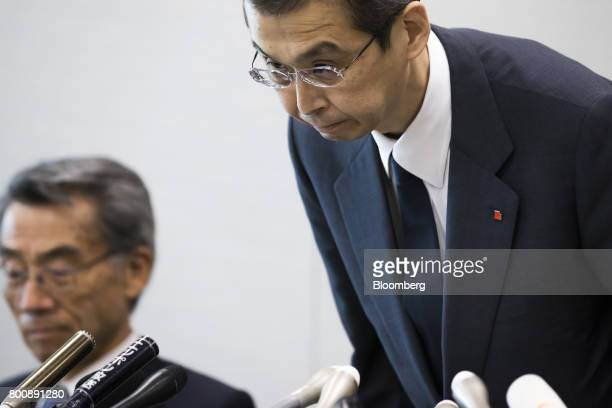 Shigehisa Takada chairman and chief executive officer of Takata Corp right bows during a news conference in Tokyo Japan on Monday June 26 2017...