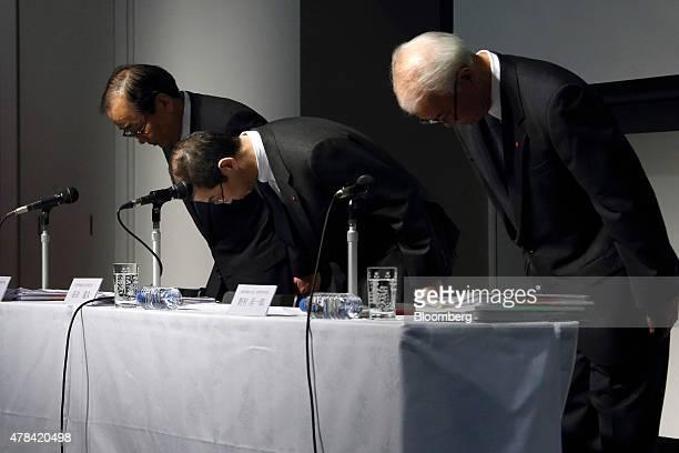 Shigehisa Takada chairman and president of Takata Corp center Hiroshi Shimizu executive vice president left and Yoichiro Nomura chief financial...