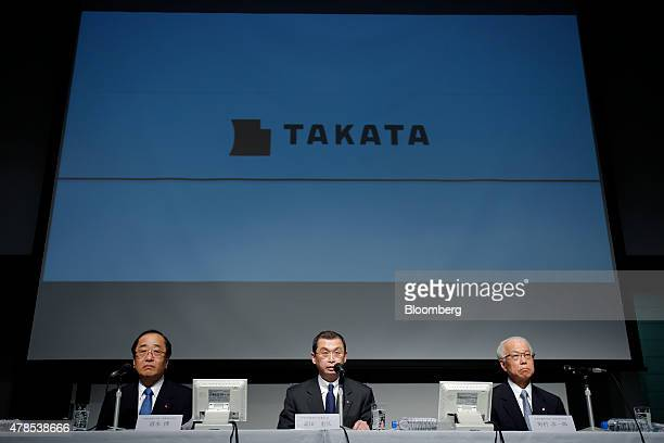 Shigehisa Takada chairman and president of Takata Corp center speaks while Hiroshi Shimizu executive vice president left and Yoichiro Nomura chief...