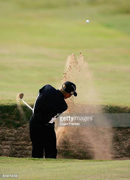 Shigeki Maruyama of Japan plays out from the bunker on the sixth hole during the first round of the 133rd Open Championship at the Royal Troon Golf...