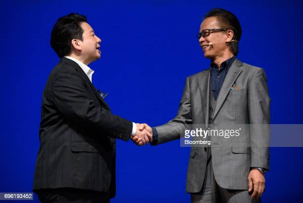 Shigeki Tomoyama senior managing officer of Toyota Motor Corp right and Jun Masuda chief strategy and marketing officer of Line Corp attend Line...