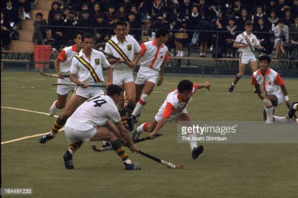 Shigeo Kaoku of Japan and Donald Smart of Australia compete during the Men's Hockey Group A match between Japan and Australia during Tokyo Olympic at...