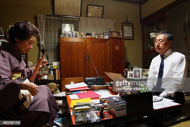 Shigera Tanabka attends singing classes with Geisha Yuko Asakusa at her home studio in the Asakusa District on November 6 2014 in Tokyo Japan 91 year...
