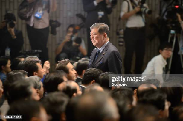 Shigeru Ishiba Japan's former defense minister center attends the Liberal Democratic Party's presidential election at its headquarters in Tokyo Japan...