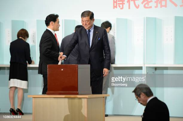 Shigeru Ishiba Japan's former defense minister center casts his ballot during the Liberal Democratic Party's presidential election at its...