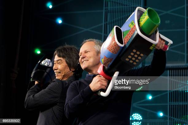 Shigeru Miyamoto representative director and creative fellow at Nintendo Co left and Yves Guillemot chief executive officer of UbiSoft Entertainment...