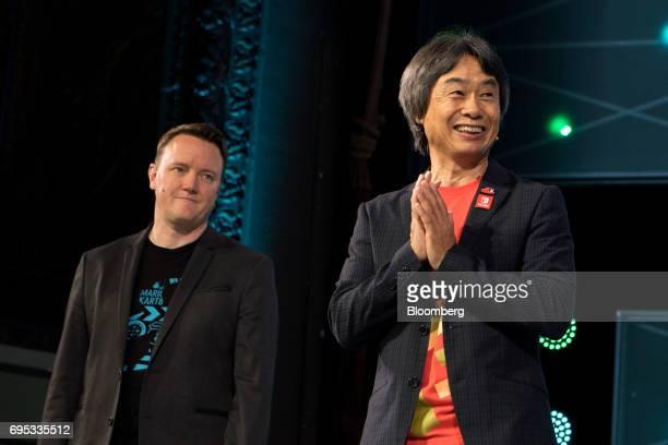 Shigeru Miyamoto representative director and creative fellow at Nintendo Co right and Bill Trinen director of product marketing of Nintendo of...