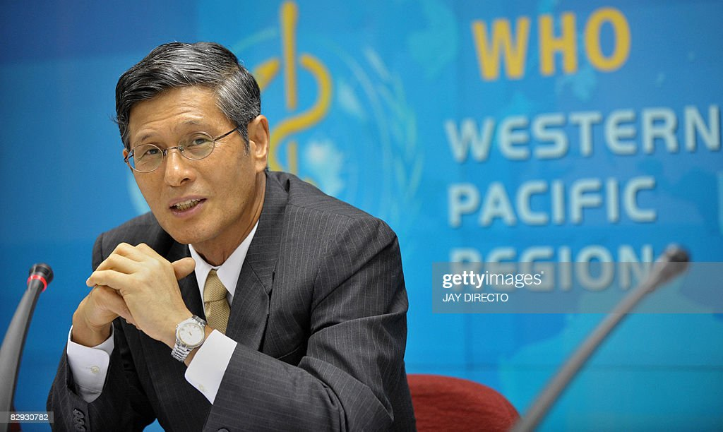 Shigeru Omi, World Health Organization (WHO) regional director, speaks during a news conference at their headquarters in Manila on September 21, 2008. The World Health Organisation said it was helping China solve its tainted milk formula problem, while criticising the government for initially failing to alert the international community. AFP PHOTO/Jay DIRECTO
