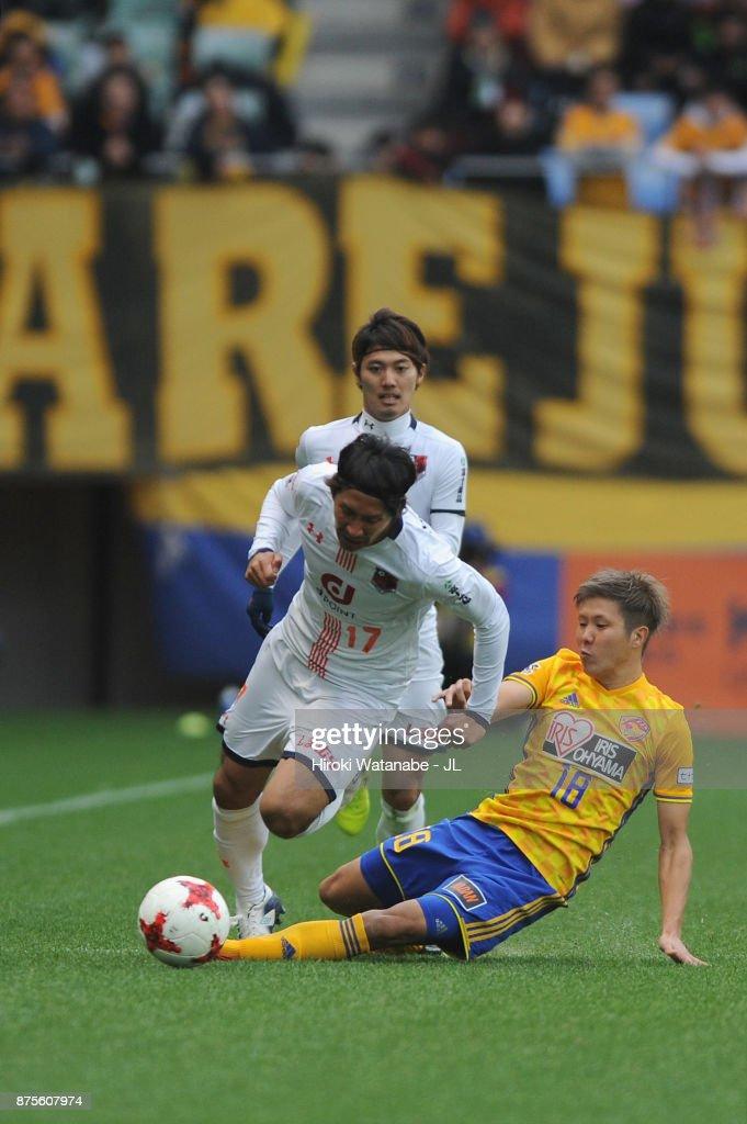 Shigeru Yokotani of Omiya Ardija is tackled by Hirotaka Mita of Vegalta Sendai during the J.League J1 match between Vegalta Sendai and Omiya Ardija at Yurtec Stadium Sendai on November 18, 2017 in Sendai, Miyagi, Japan.