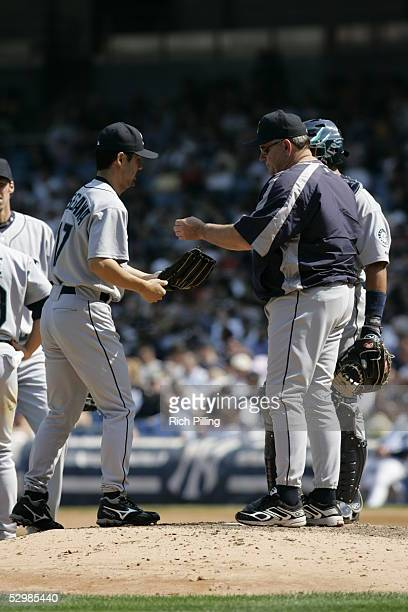 Shigetoshi Hasegawa is handed the ball by manager Mike Hargrove of the Seattle Mariners during the game against the New York Yankees at Yankee...