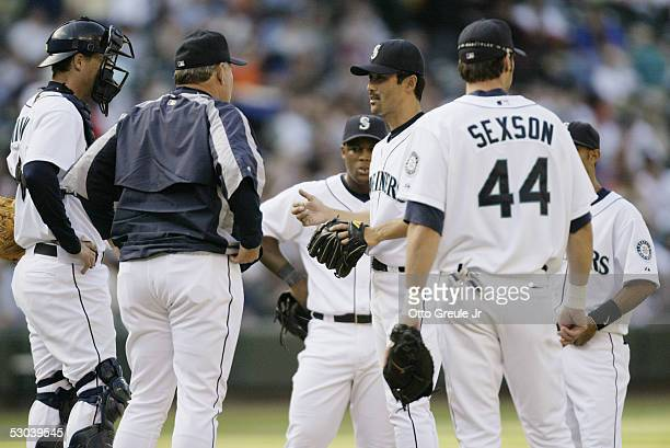 Shigetoshi Hasegawa of the Seattle Mariners has a conference on the mound with teammates during the game against the Los Angeles Angels of Anaheim on...