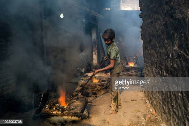 Shihab works in a metal shop near shipyard where he breaks metal small pieces and puts them into the furnace Dhaka Bangladesh February 7 2019