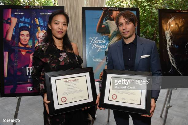 ShihChing Tsou and Sean Baker pose with their award during the 18th Annual AFI Awards at Four Seasons Hotel Los Angeles at Beverly Hills on January 5...
