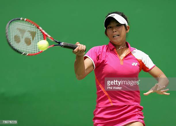Shiho Akita of Japan plays a forehand during her second round juniors match against Anastasia Pavlyuchenkova of Russia on day nine of the Australian...