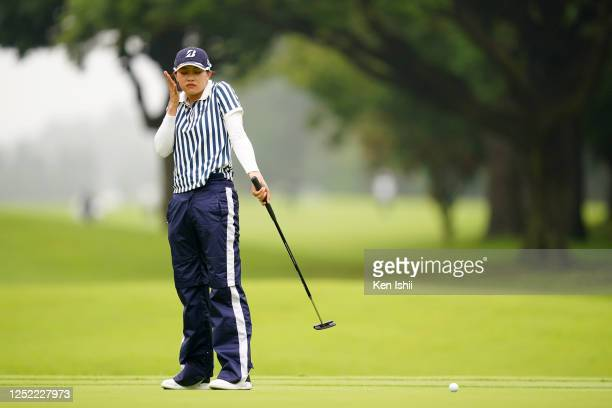 Shiho Kawasaki of Japan reacts after the birdie putt on the 8th green during the first round of the Earth Mondamin Cup at the Camellia Hills Country...