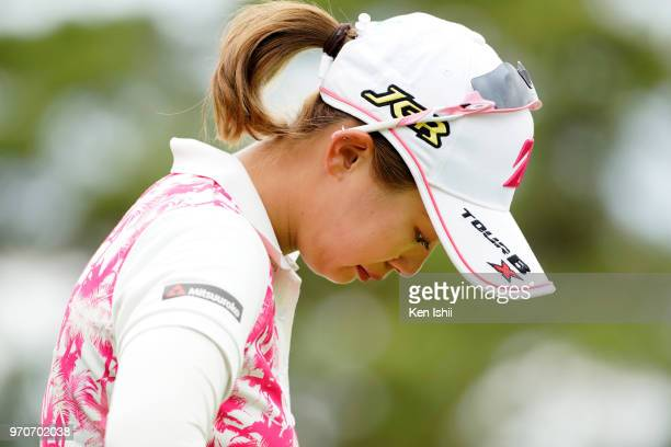 Shiho Kawasaki of Japan wipes away her tears after her putt on the 18th green during the final round of the RouteInn Cup Ueda Maruko Grandvrio Ladies...