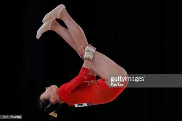 Shiho Nakaji of china in action on the Horizontal Bar during on the Floor during the Artistic Gymnastics of the Women's Team Final at the Jiexpo Hall...