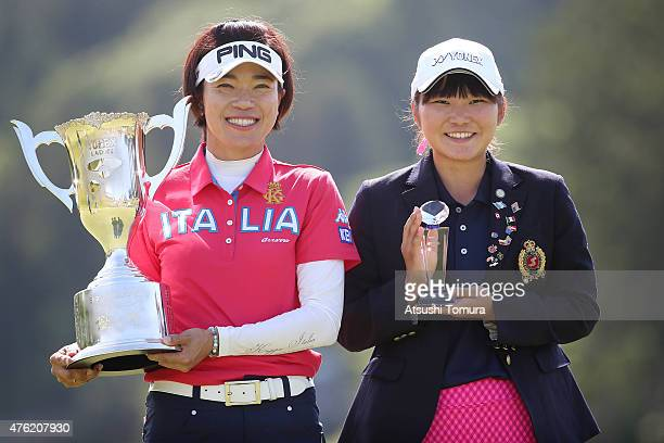 Shiho Oyama and Rio Ishii of Japan pose with the trophy after the final round of the Yonex Ladies Golf Tournament 2015 at the Yonex Country Club on...